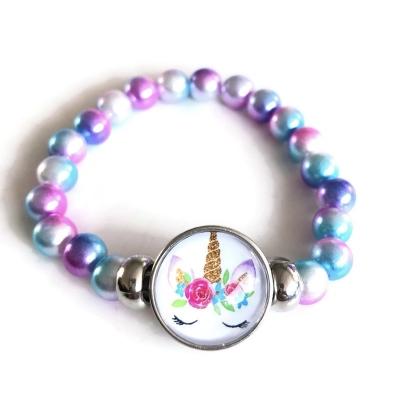 Armband, unicorn/eenhoorn-kralen lila-turquoise